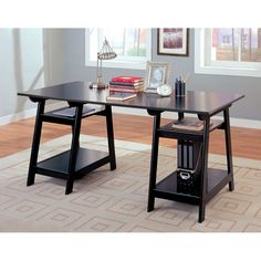 This charming desk will be a nice addition to your home office or work area. The large desk offers a generous work surface to meet your needs, with a classic molded edge. The Black glazed finish is bold, on sleek trestle style bases that form the storage pedestals, each with two shelves for all of your office essentials. Add this simple and stylish desk to your home for a functional work space that you will really love.