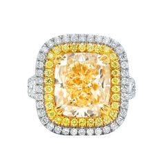 Platinum and 18K Yellow Gold Diamond Ring with Main 7.02 Carat Fancy Light Yellow Stone set in Double Halo Setting