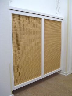 radiator cover, tilts out, uses caning