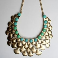"The ""Marnie"" Gold Statement Necklace Bib necklace with layers of gold texture and beaded collar details. Available in gold with green/blue and gold with ivory.  ❌No trades ❌No PayPal ❌No asking for the lowest price A-List Jewelry Jewelry Necklaces"