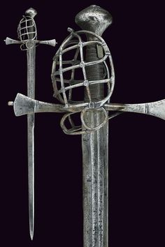 A basket-hilted sword Germany, 17th Century  Straight, double-edged blade, slightly wider at the first part, with double groove and slightly visible inscriptions; iron hilt with straight quillons thickening toward the ends, cage guard with lower side ring, large mushroom-shaped pommel chiselled at the upper part; wooden grip with iron and brass wire binding and moor's heads.