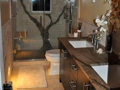 A tree done in stone in a shower - cool idea for a bathroom