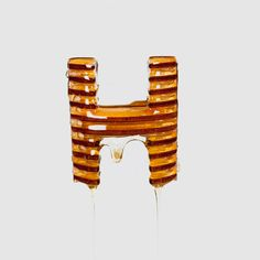 Franc Navarro partnered with classmate Alberto Martinez on a delicious typography collaboration that involved models of honey dippers and real honey. Food Typography, Typography Letters, Honey Logo, Experimental Type, Typographic Design, 3d Models, Elements Of Design, Handmade Design, Lettering Design