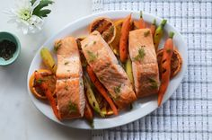 Paleo meals don't have to be boring. Fresh dill and citrus add a pop of flavor to hearty salmon fillets and tender carrots. Rem...