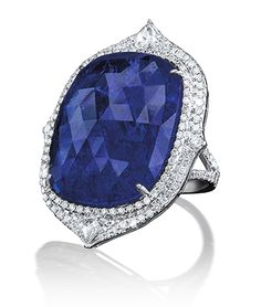 Cellini Jewelers Tanzanite and Diamond Ring with a faceted cabochon tanzanite and diamonds, in 18k white gold