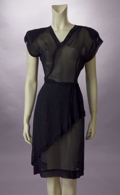 1940s sheer nylon dress.  Note the visible shoulder pads.  (Might have been less obvious than they appear here, depending on the slip style worn.)