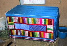 Tack trunk cover embellished with horse show ribbons.