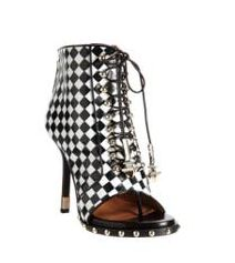 Givenchy - Check-embossed lace-up ankle boot.