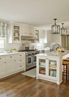 Love this Kitchen - glass front, white cabinets, countertops, pulls, lanterns