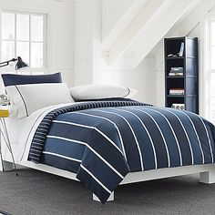 Clean, classic stripes and two shades of blue with white are the signature statement of this timeless comforter set. Comforter reverses to a navy and white stripe pattern for a coordinating look.