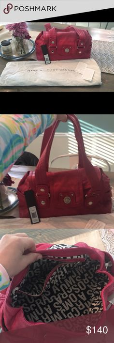 """Pink Marc by Marc Jacobs Purse 👛 Size 15x8x8 with strap drop length of 10-11""""  Marc by Marc Jacobs  Gorgeous bright pink raspberry color  ***also see ad for matching wallet***  Comes in original dustbag and with original tags   Silver hardware on purse   EUC lightly used and well maintained  Only flaw I can find is in pic 7 ... hardly noticeable slight discoloration. Pointed to —- approx size of half dollar. Marc By Marc Jacobs Bags"""
