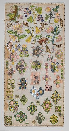 Sampler Date: mid-17th century Culture: British Medium: Canvas worked with silk and metal thread; tent, cross, back, plaited braid, knots, laid work, and detached buttonhole stitches Dimensions: H. 21 3/4 x W. 10 5/8 inches (55.2 x 27 cm); Framed: H. 22 3/8 x W. 11 3/8 x D. 1 inch (56.8 x 29.2 x 2.5 cm) Classification: Textiles-Embroidered