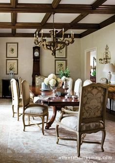 In the dining room, designers Will Huff and Heather Dewberry reserved the most precious fabrics for the host and hostess chairs.