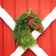 Handmade Holiday Horse Wreath Door Hangar  Approximately 24 inches tall and 19 inches wide. Its made from real fresh live Cedar, White Pine, Juniper, Holly, Cedar Rose Pine-cones, Red Grosgrain Ribbon and an Ohio Buckeye for the eye. This gorgeous horse head wreath is the perfect gift for the equestrian in your family. Burlap back side protects door from scratches. The wreath comes ready to hang on your door.  *Shipping starts Nov 27, 2017. If you would like your wreath shipped at a…