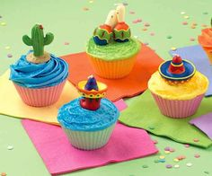Fiesta Cupcakes - Add a little south of the border accent to you parties with these festive cupcakes topped with bold sombrero candles. Fancy Cupcakes, Themed Cupcakes, Yummy Cupcakes, Churro Cupcakes, Mexican Birthday Parties, Mexican Fiesta Party, Wilton Cake Decorating, Cake Decorating Tools, Decorating Ideas