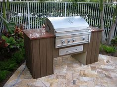 outdoor kitchen with stucco and granite top. | home decor