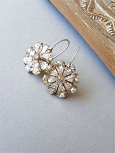 The Jadis earrings - stunning vintage Swarovski crystal studded flowers are enhanced with a modern Swarovski crystal in the centre.  Finished with sterling hand forged ear wires, these snug the lobes, and are uber sparkly!