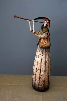 Katia was born in Russia, Siberia but now is living in Cyprus. This can be a reason for the warm color palette used for her papier mache and clay doll sculpture what quite recall the way of Rubens. The doll sculptures usually are 28 - 30 cm tall and each one prove a great inspiration for the fabric