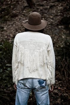 fabulous sweater where eagle is knitted in reverse pattern and yarn fringe applied emulating buckskin jacket with beading and fringe