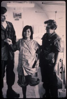 95th Evac Hospital. A young Vietnamese girl learns how to walk again, with the help of a corpsman and Nurse (Names Unknown)