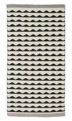 Black White Patterened Rug Runner by Danish design company Aspegren. This cotton rug comes in a black and off white triangle pattern, with a