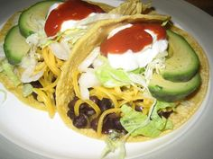 Black Bean and Avocado Tacos from Food.com: Yummo!!  I love the flavor combination of black beans and avocado! Using reduced fat sour cream and cheese, a serving of 2 tacos is 11 points (WW).