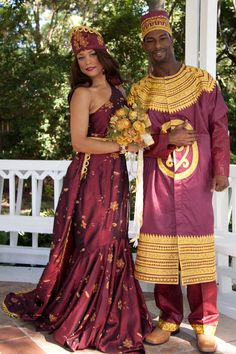 AYANA and ANWAR are African names used to describe the matching man''''s and woman''''s outfits. AYANA is an Ethiopian female name meaning beautiful flower.	The beautiful gold flowers on the silk satin dress and detachable train symbolizes Ayana. The asymetrical neckline on the woman''''s dress is stunning! The fabric is embroidered with gold flowers.  Dress has gold trim waist band with detachable train. Gold trim is stitched all around edge of the train. Lined. The gold trimmed hat is…