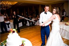 Cutting the cake with the West Point saber! Michelle and Brian's Wedding – West Point, NY : Adam Nyholt, Photographer
