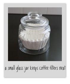 A small glass jar keeps coffee filters neat.