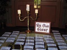 Our placecard table for our Disney themed wedding.  We edited the actual old Key to the World with wording to go along with our Wedding name, guest names and table numbers.  We purchased a candelabra and put on a Lumiere face.  Guests loved it!  #disneywedding #placecards #beourguest