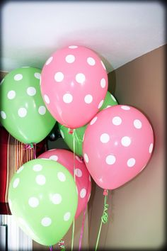 Pink and green balloons