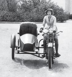 Easter Walters on a 1920's Harley Davidson motorcycle with sidecar. Easter was an actress and motorcycle enthusiast.