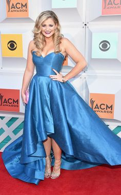 "Lauren Alaina from ACM Awards 2016 Red Carpet Arrivals  The ""Next Boyfriend"" singer adds a pink clutch to her ocean blue gown."