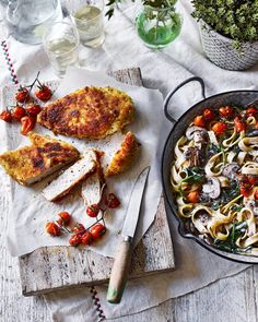 Mushroom tagliatelle alfredo with roast tomatoes and chicken milanese  Creamy mushroom tagliatelle alfredo is served with crispy breadcrumbed chicken and sweet roasted vine tomatoes.