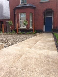 Town House in Dublin with gold granite path, pebbling and small flower beds Dublin House, Front Path, Granite Flooring, Town House, Landscaping Company, Small Flowers, Flower Beds, Paths, Garden Design