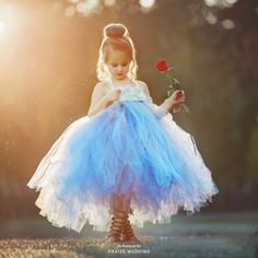 This adorable flower girl dress from Boutique 3-21 is perfectly made to fulfill a princess dream!