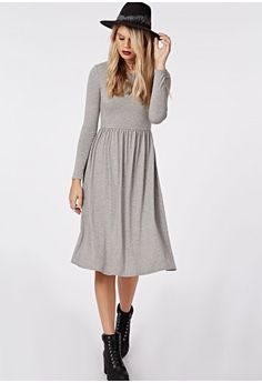 This easy wear long sleeve jersey dress is a layering dream perfect for this season. A midi dress with fit and flare skater style with cinched elasticated waist in a jersey fabric is smokin'. Team this with cute ankle boots and lots of la...