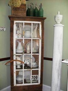 Cabinet made from an old window and salvaged barn wood. Love it ! (from Must Love Junk)