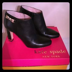 """HP ✨ Kate Spade - Aldaz ✨ DETAILS:  A signature bow lends gilt gleam to a lavish black leather bootie with an elegant, curvy toe. 3 1/2"""" heel. 5"""" boot shaft. Side zip closure. Leather upper, lining and sole. By kate spade new york; made in Italy.  CONDITION: New with box and dust bag. Never been worn. No flaws. 100% Authentic. kate spade Shoes Ankle Boots & Booties"""