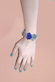 EnAvril's blue embroidered-seashell bracelet brings the beach vibes. #etsyjewelry