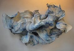 Peter Gentenaar is a paper artist based in the Netherlands. He explores the sculptural potential of paper by reinventing it and turning it away from its daily use as a flat material. The amorphous flo