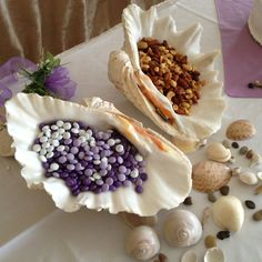 Use giant shells from the ocean to hold nuts, m and more for a wedding or graduation. Beach themed wedding