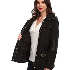 NWOT- Sleek Calvin Klein Quilted Jacket w/ Belt Calvin Klein's quilted utility jacket boasts faux-leather elbow patches and glamorous gold-tone hardware, updated in a sleek silhouette with plenty of pockets. • Flap collar, optional zip-out hood, long quilted sleeves with snap cuffs • Faux leather elbow patches, two chest snap flap patch pockets • Detachable belt with buckle, two hip snap flap patch pockets • Concealed front zip with snap storm flap, quilted sides, gold-tone hardware, filled…