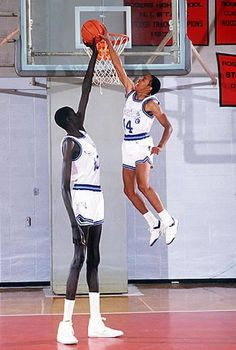 Manute Bol (left) next to Spudd Webb (right). Both NBA players known for their size, but opposites in every other way. Spudd Webb won the 1986 NBA Dunk Contest, overcoming the odds. Manute Bol was tied for tallest man ever in the NBA, and Spudd Webb was o Sport Basketball, Basketball Pictures, Love And Basketball, Basketball Legends, Basketball Players, Basketball Jones, Basketball History, Basketball Stuff, Basketball Tattoos