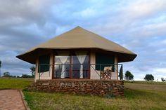 Karatu Simba Lodge: Eco-friendly Lodging with Stunning Views in Karatu Tanzania - Independent Travel Cats Village House Design, Village Houses, Chalet Style, Thatched Roof, Round House, Small Farm, Stay The Night, Travel And Tourism, Log Homes