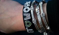 Customer wearing a Charmsations charm bracelet. Love how she paired it with the other bracelets for some added bling!
