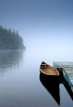 Canoe on the lake.  See the fog?  Means that Old Man Winter is around the corner.
