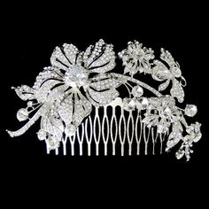 Bridal Hair Comb, Flower Hair Comb, Butterfly Wedding Jewelry, Vintage Inspired Swarovski Crystal, Clear Rhinestone Hair Accessories. $35.99, via Etsy.