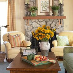 Cozy living room - love the arrangement of furniture and type of chairs