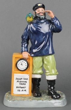 """Lot 105, A Royal Doulton figure - All Aboard HN2940 9"""", sold for £65"""